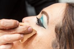 Applying foundation using a sponge to a white woma Royalty Free Stock Photos