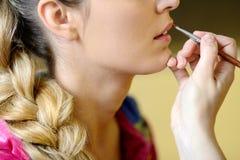 Applying glow with make-up brush Stock Image