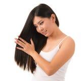 Applying hair cream royalty free stock image