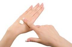 Applying hand cream. Application of hand cream isolated on white background Stock Photo