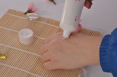 Applying hand cream. A woman is applying hand cream which has good scent and can soothe and moisturize the skin Stock Images