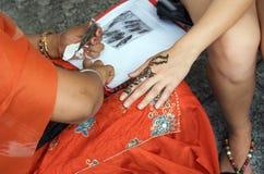 Applying Henna Stock Photos