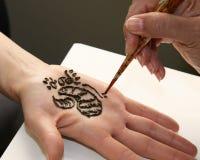 Applying Henna Stock Photography