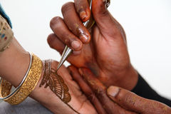 Applying henna Royalty Free Stock Photos