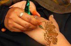 Applying henna or Mehendi a temporary tattoo Stock Photos