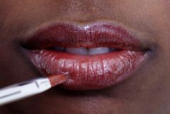 Applying Lip-gloss Royalty Free Stock Photos