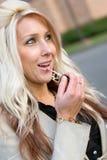 Applying Lip Gloss Royalty Free Stock Photo