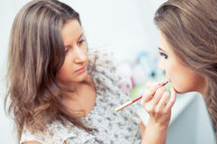 Applying lip liner Stock Photo