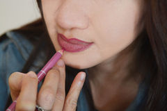 Applying a lip liner Stock Images