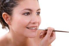 Applying lipgloss Stock Photos
