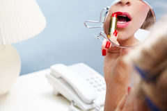 Applying lipstick Royalty Free Stock Images