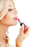 Applying lipstick Stock Photo