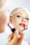 Applying lipstick Stock Photos