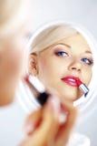 Applying lipstick Stock Photos