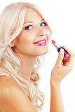 Applying lipstick Royalty Free Stock Photos