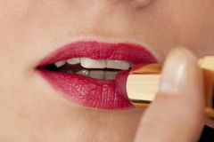 Applying lipstick Stock Image
