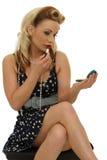 Applying lipstick Royalty Free Stock Image