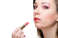 Applying lipstick Stock Images