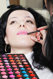 Applying lipstick Stock Photography