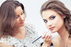 Applying lipstick with a brush Stock Photos