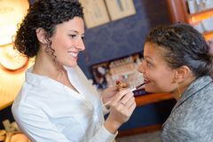 Applying lipstick on client. Applying a lipstick on the client Stock Image