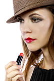 Applying Lipstick Royalty Free Stock Photos