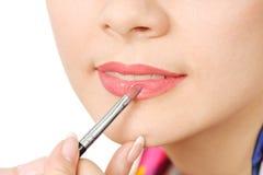 Applying liquid glossy lipstick Stock Image