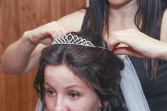Applying little crown Royalty Free Stock Photography