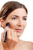 Applying make-up Royalty Free Stock Photos