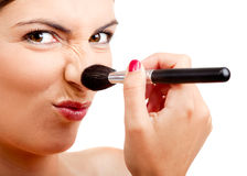Applying make-up Royalty Free Stock Images