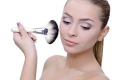 Applying make-up Royalty Free Stock Photography