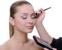 Applying make-up Stock Images