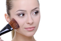 Applying make-up Royalty Free Stock Photo