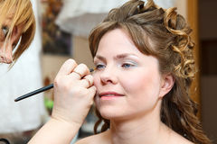Applying make up Stock Photo