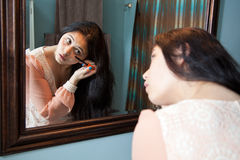 Applying make up Stock Image