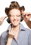 Applying make-up Royalty Free Stock Image