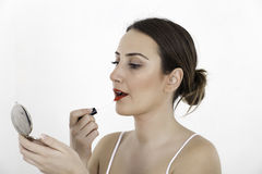 Applying make-up stock photos