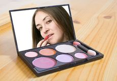 Applying make up Royalty Free Stock Images