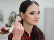 Applying Make-up Royalty Free Stock Photo