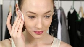 Applying make up brush on model caucasian woman face stock video footage