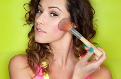 Applying make up concept Royalty Free Stock Photography