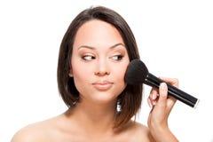 Applying make up royalty free stock photo