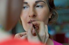 Applying makeup. Shot of beautiful young woman applying makeup Royalty Free Stock Photos