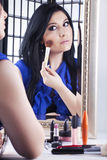 Applying makeup Stock Photos