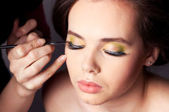 Applying Makeup Royalty Free Stock Image