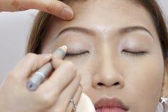 Applying makeup Royalty Free Stock Photography