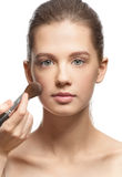 Applying makeup Royalty Free Stock Photo