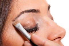 Applying makeup. Closeup macro shot Royalty Free Stock Photography