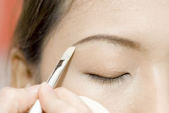 Applying makeup royalty free stock photo