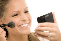 applying makeup Στοκ Εικόνες